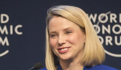 Yahoo CEO Marissa Mayer smiles during a session at the World Economic Forum in Davos, Switzerland, in this Wednesday, Jan. 22, 2014, file photo. Mayer posted on Tumblr, Monday, Aug. 31, 2015, that she's pregnant with twin girls, due in December. (AP Photo/Michel Euler, File)