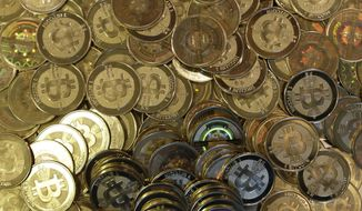 This photo shows bitcoin tokens in Sandy, Utah. (Associated Press) **FILE**