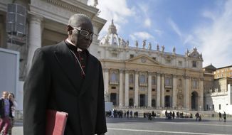 Cardinal Robert Sarah, of Guinea, walks in St. Peter's Square after attending a cardinals' meeting, at the Vatican, Monday, March 4, 2013. Cardinals from around the world have gathered inside the Vatican for their first round of meetings before the conclave to elect the next pope, amid scandals inside and out of the Vatican and the continued reverberations of Benedict XVI's decision to retire. (AP Photo/Andrew Medichini)