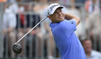 Bill Haas watches his tee shot on the first tee during the first round of the Quicken Loans National Golf tournament at the Robert Trent Jones Golf Club in Gainesville, Va., Thursday, July 30, 2015. (AP Photo/Nick Wass)