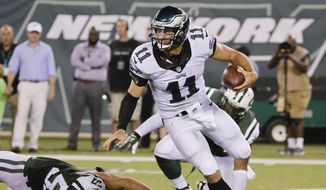 Philadelphia Eagles quarterback Tim Tebow (11) avoids a sack by New York Jets' Trevor Reilly (57) during the first half of a preseason NFL football game Thursday, Sept. 3, 2015, in East Rutherford, N.J. (AP Photo/Peter Morgan)