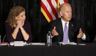 Democratic National Committee Chairwoman, Rep. Debbie Wasserman Schultz, D-Fla., left, looks on as Vice President Joe Biden discusses the Iran nuclear deal with Jewish community leaders at the David Posnack Jewish Community Center in Davie, Fla. on Thursday, Sept. 3, 2015. Exploring a presidential campaign, Biden offered a robust defense of a nuclear accord with Iran strongly backed by the White House in the latest sign of his work to present himself as a natural heir to President Barack Obama. (AP Photo/Joel Auerbach)
