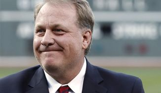 "In this Aug. 3, 2012, file photo, former Boston Red Sox pitcher Curt Schilling reacts after being introduced as a new member of the Boston Red Sox Hall of Fame, at Fenway Park in Boston. ESPN says commentator Schilling won't appear on the air for the next month in the wake of his anti-Muslim tweet. ESPN said Thursday, Sept. 3, 2015, that Schilling won't be on telecasts for the rest of the regular season or the American League wild-card game on Oct. 6. The former star pitcher and ""Sunday Night Baseball"" analyst was pulled by ESPN from a major league game and the network's coverage of the Little League World Series last month after he retweeted a post that compared Muslim extremists and Nazis. (AP Photo/Winslow Townson, File)"