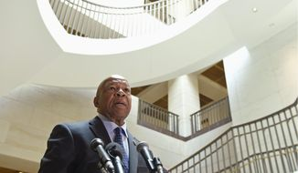 Rep. Elijah E. Cummings asked his colleagues in the GOP to suspend their investigations into Planned Parenthood in the wake of the recent videos released by an anti-abortion group, saying that the group's tactics may not be telling the entire story and rather backing an agenda. (Associated Press)
