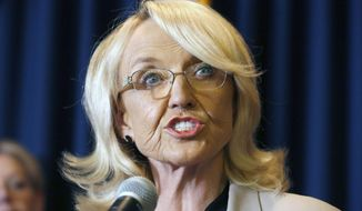 "In this Sept. 4, 2013, file photo, Arizona Gov. Jan Brewer speaks in Phoenix. Two online marketing companies are ceasing publication of ads that depict former Arizona Gov. Jan Brewer as an over-the-hill divorcee who needed a ""revenge makeover"", Thursday, Sept. 3, 2015. (AP Photo/Ross D. Franklin, File)"
