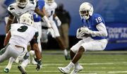 Georgia State wide receiver Robert Davis (19) runs after a reception against Charlotte defensive back Branden Dozier (3) during the first half of an NCAA college football game Friday, Sept. 4, 2015, in Atlanta. (Jason Getz/Atlanta Journal-Constitution via AP)  MARIETTA DAILY OUT; GWINNETT DAILY POST OUT; LOCAL TELEVISION OUT; WXIA-TV OUT; WGCL-TV OUT; MANDATORY CREDIT