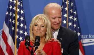 In this file photo taken on June 23, 2014, Jill Biden introduces her husband, U.S. Vice President Joe Biden, at The White House Summit on Working Families, in Washington. (AP Photo/Charles Dharapak, File)