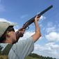 Will Rupli, 13, aims during a dove shoot. It is common to see three generations of one family take part in a dove shoot. (Tim Rupli)