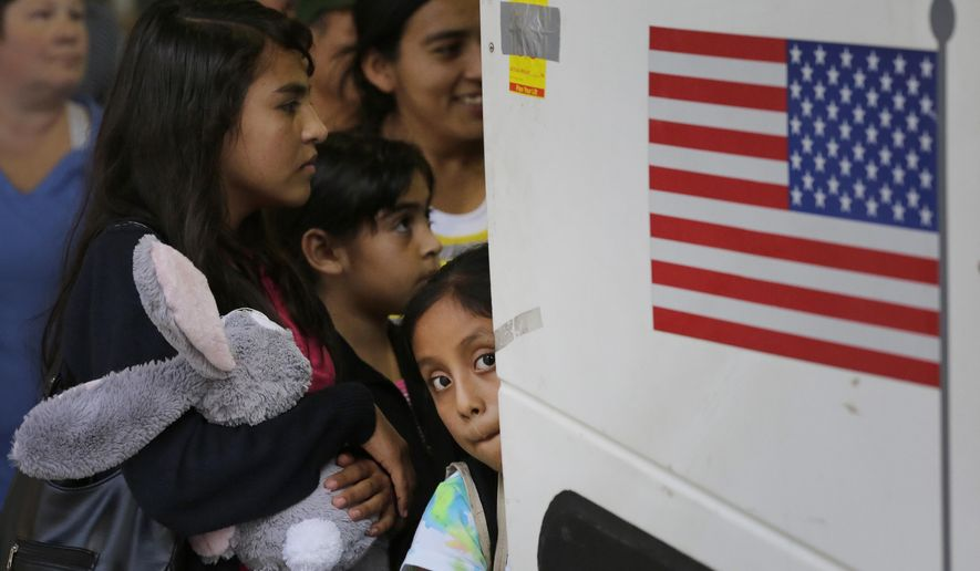 FILE - In this Tuesday, July 7, 2015 file photo immigrants from El Salvador and Guatemala who entered the country illegally board a bus after they were released from a family detention center in San Antonio. Women and children are being released from immigrant detention centers faster on bond, with many mothers assigned ankle-monitoring bracelets in lieu of paying. (AP Photo/Eric Gay, File)