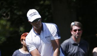 Henrik Stenson, of Sweden, chips onto the first green during the third round of the Deutsche Bank Championship golf tournament in Norton, Mass., Sunday, Sept. 6, 2015. (AP Photo/Michael Dwyer)