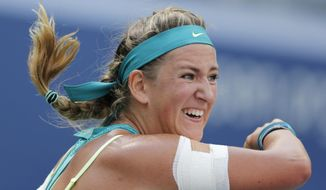 Victoria Azarenka, of Belarus, follows through on a shot to Varvara Lepchenko, of the United States, during the fourth round of the U.S. Open tennis tournament, Monday, Sept. 7, 2015, in New York. (AP Photo/Charles Krupa)