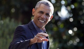 President Barack Obama waves as he walks from the White House and to board Marine One helicopter, Monday, Sept. 7, 2015, in Washington, for the short trip to Andrews Air Force Base and onto Boston where he will speak at the Greater Boston Labor Council Labor Day Breakfast. (AP Photo/Carolyn Kaster)