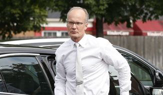 Dentist Walter Palmer, who returned to his practice, Tuesday, Sept. 8, 2015, in Bloomington, Minn., arrives back to his office following a lunch break. Palmer, after weeks out of the public eye, was the subject of an international uproar after he was identified as the hunter who killed the famous lion Cecil, in Zimbabwe. (AP Photo/Jim Mone)