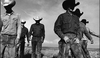"This photograph titled ""Cowboys Walking,"" by Laura Wilson at J. R. Green Cattle Company in Shackelford County, Texas, May 13, 1997, is one the Dallas photographer's images of the American West featured in a new exhibit at a Fort Worth museum. The exhibit titled ""That Day: Laura Wilson"" opened Saturday, Sept. 5, 2015, at the Amon Carter Museum of American Art. The exhibit featuring more than 70 of her photographs runs through Feb. 14.  (Laura Wilson/Amon Carter Museum of American Art via AP)"