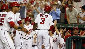 Washington Nationals' Michael Taylor (3) celebrates after his single and an error by New York Mets center fielder Yoenis Cespedes allowed four runs to score, during the sixth inning of a baseball game at Nationals Park, Tuesday, Sept. 8, 2015, in Washington. (AP Photo/Alex Brandon)