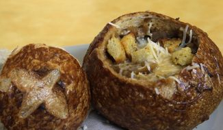 This June 9, 2015, file photo, shows a Bistro French Onion Soup Bread Bowl at a Panera bread restaurant in New York. The city Board of Health voted unanimously Wednesday, Sept. 9 to require chain eateries to put salt-shaker symbols on menus to denote dishes with more than the recommended daily limit of 2,300 milligrams of sodium. (AP Photo/Mary Altaffer, File)