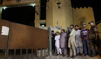 Family members of Shafqat Hussain, who was convicted and hanged for killing a boy, wait to receive his body outside the central jail in Karachi, Pakistan, in this Tuesday, Aug. 4, 2015, file photo. (AP Photo/Fareed Khan, file)