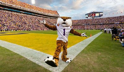 "Mike the Tiger was once featured on a ""This Is Sports Center"" commercial with Shaquille O'Neal, an alum from which school?"