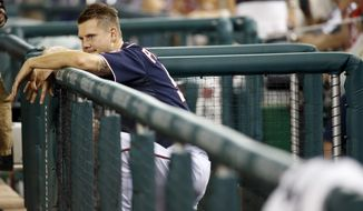 Washington Nationals relief pitcher Jonathan Papelbon leans over the rail of the dugout and watches the New York Mets celebrate after a baseball game at Nationals Park, Wednesday, Sept. 9, 2015, in Washington. The Mets won 5-3. (AP Photo/Alex Brandon)