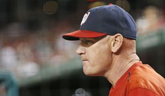 Washington Nationals manager Matt Williams stands in the dugout during the ninth inning of a baseball game against the New York Mets at Nationals Park, Wednesday, Sept. 9, 2015, in Washington. The Mets won 5-3. (AP Photo/Alex Brandon)