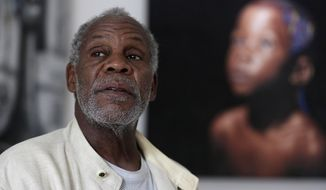 U.S actor Danny Glover speaks to The Associated Press during an interview in Lagos, Nigeria Thursday, Sept. 10, 2015. Glover is in Nigeria to star in a movie based on people who risked and sacrificed their lives to stop the spread of Ebola in Africa's most populous country. (AP Photo/Sunday Alamba)