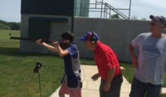 Tim Rupli's son gets pre-season pointers from Hillsdale College champion shooting team coaches. (Photo by Tim Rupli)