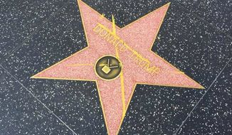 Donald Trump's Walk of Fame star on Hollywood Boulevard has been defaced with a large yellow X. IJ Review reporter Hunter Schwarz shared a photo of the graffiti Thursday afternoon. (Twitter/@HunterSchwarz)