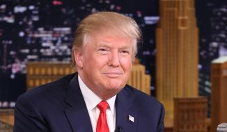 """In this image released by NBC, Republican presidential candidate Donald Trump appears during a taping of """"The Tonight Show Starring Jimmy Fallon,"""" on Friday, Sept. 11, 2015, in New York. (Douglas Gorenstein/NBC via AP)"""