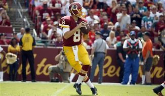 Washington Redskins quarterback Kirk Cousins (8) drops back to pass during the first half of an NFL football game against the Miami Dolphins, Sunday, Sept. 13, 2015, in Landover, Md. (AP Photo/Evan Vucci)