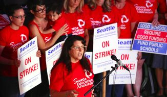 Phyllis Campano, vice president of the Seattle Education Association, addresses the media during an update of negotiations Sunday, Sept. 13, 2015, in Seattle. Seattle Public Schools is canceling classes for a fourth day Monday as a strike by teachers enters its second week. (John Lok/The Seattle Times via AP) SEATTLE OUT; USA TODAY OUT; MAGS OUT; TELEVISION OUT; NO SALES; ONLINE OUT; MANDATORY CREDIT TO BOTH THE SEATTLE TIMES AND THE PHOTOGRAPHER