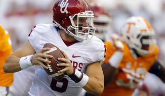 FILE - In this Saturday, Sept. 12, 2015, file photo, Oklahoma quarterback Baker Mayfield (6) runs for yardage during the first half of an NCAA college football game against Tennessee in Knoxville, Tenn. For years, Mayfield dreamed of creating dramatic victories for the Sooners. After a 17-point comeback against Tennessee, those heroics are now real for the walk-on.   (AP Photo/Wade Payne, File)