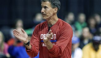 FILE - In this Oct. 5, 2013, file photo, Detroit Pistons strength and conditioning coach Arnie Kander claps during the Pistons NBA basketball camp at the Palace of Auburn Hills, Mich. The Minnesota Timberwolves hired the Kander on Monday, Sept. 14, 2015,  to head their revamped athletic training staff.  (AP Photo/Carlos Osorio, File)
