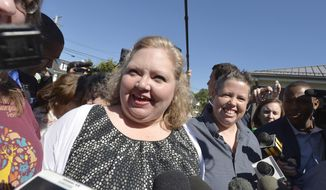 Carmen Wampler-Collins, left, and her partner Shannon Wampler-Collins speak with the media on the lawn of the Rowan County Judicial Center in Morehead, Ky. Monday, Sept. 14, 2015. The couple received their marriage license following Rowan County Clerk Kim Davis' announcement earlier that her office will issue marriage licenses under order of a federal judge, but they will not have her name or office listed. (AP Photo/Timothy D. Easley)