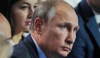 Blame game: Russian President Vladimir Putin, while bolstering military aid to Syria, said U.S. moves have deepened the ongoing refugee crisis. (Associated Press)
