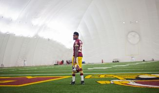 Washington Redskins DeSean Jackson poses on the field during the filming in an in-house promotional video at Redskins Park, on Wednesday, June 3, 2015, in Ashburn, Va. (AP Photo/Pablo Martinez Monsivais)