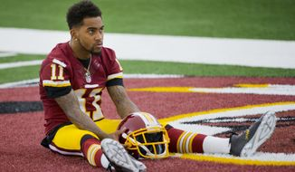 Washington Redskins wide receiver DeSean Jackson poses for an in-house promotional video following an NFL football organized team activity at Redskins Park, on Wednesday, June 3, 2015, in Ashburn, Va. (AP Photo/Pablo Martinez Monsivais)