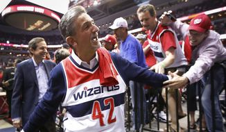 Wearing a Nene jersey, Washington Wizards owner Ted Leonsis walks off the floor after Game 4 of an opening-round NBA basketball playoff series against the Chicago Bulls in Washington, Sunday, April 27, 2014. The Wizards defeated the Bulls 98-89. Wizards forward Nene was suspended for an altercation in Game 3. (AP Photo/Alex Brandon)