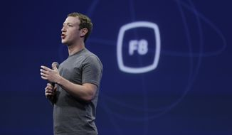 "In this March 25, 2015, file photo, CEO Mark Zuckerberg gestures while delivering the keynote address at the Facebook F8 Developer Conference in San Francisco. Zuckerberg said Tuesday, Sept. 15, Facebook may finally be getting a button that lets you quickly express something beyond a ""like."" (AP Photo/Eric Risberg, File)"