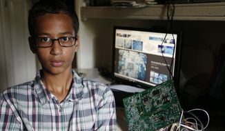 "Ahmed Mohamed with his ""clock."" (The Dallas Morning News via Associated Press)"