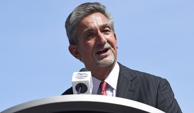 Washington Capitals owner Ted Leonsis speaks at an event to unveil the team's uniform for the 2015 Bridgestone WInter Classic hockey game, Tuesday, Sept. 23, 2014, at Nationals Park in Washington. The Capitals will play the Chicago Blackhawks in the game that will be played New Years Day at Nationals Park. (AP Photo/Susan Walsh)
