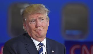 Donald Trump took much of the fire in the early part of the debate, with debate moderator Jake Tapper of CNN asking the other candidates whether they would trust Mr. Trump as commander in chief. (Associated Press) ** FILE **