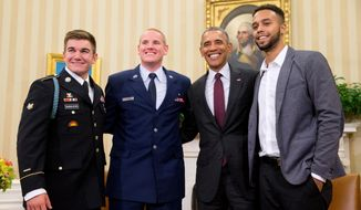 President Barack Obama poses for a photograph with Oregon National Guardsman, from left, Alek Skarlatos Air Force Airman 1st Class Spencer Stone, and Anthony Sadler, in the Oval Office of the White House in Washington, Thursday, Sept. 17, 2015, to honor them for heroically subduing a gunman on a Paris-bound passenger train last month. (AP Photo/Andrew Harnik)