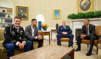 President Barack Obama meets with, from left, Oregon National Guardsman Alek Skarlatos, Anthony Sadler, and Air Force Airman 1st Class Spencer Stone in the Oval Office of the White House in Washington, Thursday, Sept. 17, 2015, to honor them for heroically subduing a gunman on a passenger train in Paris last month. (AP Photo/Andrew Harnik)