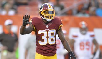 Washington Redskins defensive back Dashon Goldson stands on the field during an NFL preseason football game against the Cleveland Browns Thursday, Aug. 13, 2015, in Cleveland. Washington won 20-17. (AP Photo/David Richard)