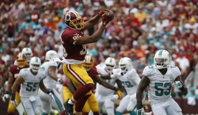 Washington Redskins tight end Jordan Reed (86) catches a pass in front of Miami Dolphins outside linebacker Jelani Jenkins (53) during the second half of an NFL football game Sunday, Sept. 13, 2015, in Landover, Md. (AP Photo/Evan Vucci)