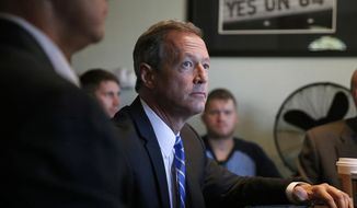 Democratic presidential candidate and former Maryland Gov. Martin O'Malley attends a round table meeting with regulators, business owners and activists from the state's marijuana industry in Denver on Sept. 17, 2015. O'Malley repeated his pledge to reclassify marijuana under federal drug laws if elected. (Associated Press) **FILE**