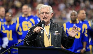 FILE - In this Oct. 13, 2014, file photo, former St. Louis Rams head coach Dick Vermeil speaks at halftime during an NFL football game between the Rams and the San Francisco 49ers in St Louis. Vermeil hopes the Rams stay in St. Louis. But, as he told reporters during the team's practice earlier this week, it's only hope. The Rams announced they'd distributed 51,792 tickets for the opener and a stadium that seats 66,000 appeared less than two-thirds full. (AP Photo/Billy Hurst, File)