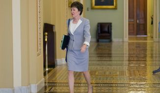 FILE- In this Tuesday, Sept. 8, 2015 file photo, Sen. Susan Collins, R-Maine, walks to the Senate floor at the Capitol in Washington. Collins, who once twisted her ankle while trying to run in heels to avoid missing a vote,  is approaching her 6,000th consecutive vote. (AP Photo/Pablo Martinez Monsivais, file)