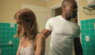 "In this image released by Paramount Pictures, Kate Mara portrays Ashley Smith, left, and David Oyelowo portrays Brian Nichols in a scene from ""Captive.""  (Evan Klanfer/Paramount Pictures via AP)"