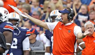 FILE - In this Saturday, Sept. 12, 2015, file photo Auburn head coach Gus Malzahn reacts to a targeting call against his team during the first half of an NCAA college football game against Jacksonville State in Auburn, Ala. The NCAA tightened penalties for targeting players in 2013 by adding an automatic ejection. After a rash of targeting penalties over college football's first two weeks, it appears the officials are cracking down even more. (AP Photo/Butch Dill, File)